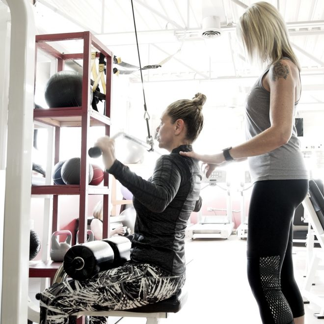 Female, personal training client, with trainer